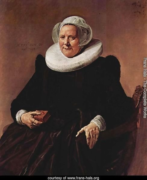 Portrait of a sitting, sixty year old woman with book in his right hand
